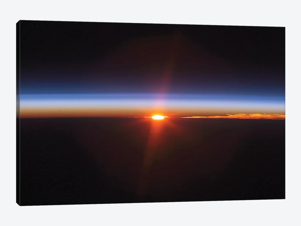 Layers Of Earth's Atmosphere, Brightly Colored As The Sun Sets Over South America by Stocktrek Images 1-piece Canvas Print