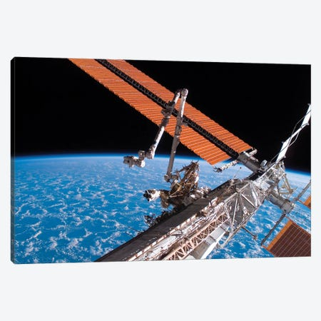The Canadarm2 And Solar Array Panel Wings On The International Space Station Canvas Print #TRK1710} by Stocktrek Images Canvas Wall Art