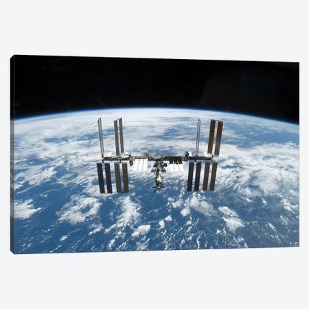The International Space Station In Orbit Above Earth Canvas Print #TRK1722} by Stocktrek Images Art Print