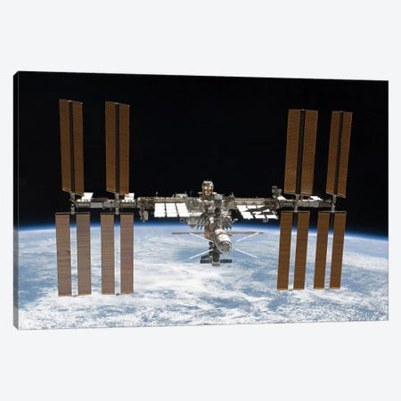 The International Space Station In Orbit Above Earth Canvas Print #TRK1723} by Stocktrek Images Canvas Print