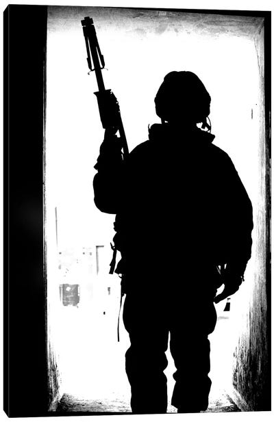 Silhouette Of A British Soldier In A Doorway At Camp Condor, Iraq Canvas Art Print