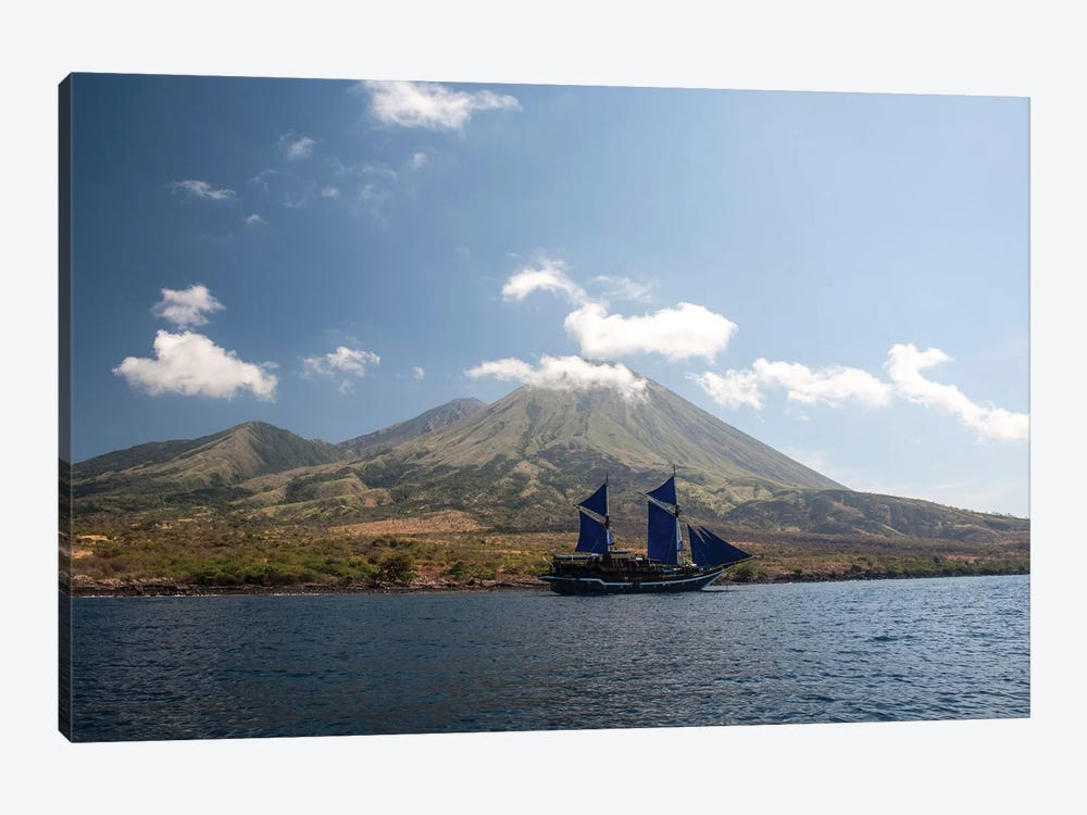 An Indonesian Pinisi Schooner Sails Near A Remote Volcanic Island by Ethan Daniels 1-piece Art Print