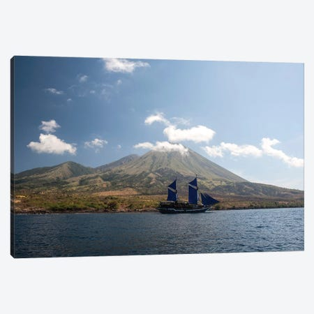 An Indonesian Pinisi Schooner Sails Near A Remote Volcanic Island Canvas Print #TRK2051} by Ethan Daniels Canvas Art Print