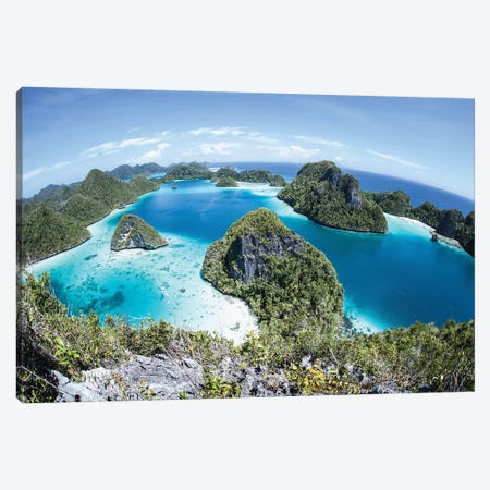 Rugged Limestone Islands Surround A Gorgeous Lagoon In Raja Ampat II Canvas Print #TRK2072} by Ethan Daniels Art Print