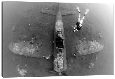 Diver Explores The Wreck Of A Mitsubishi Zero Fighter Plane Canvas Art Print