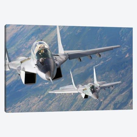 A Pair Of Bulgarian Air Force MiG-29s Aircraft Over Bulgaria Canvas Print #TRK230} by Daniele Faccioli Canvas Wall Art