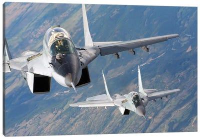 A Pair Of Bulgarian Air Force MiG-29s Aircraft Over Bulgaria Canvas Art Print