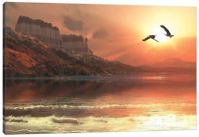 Two Bald Eagles Fly Along A Mountainous Coastline At Sunset Canvas Art Print