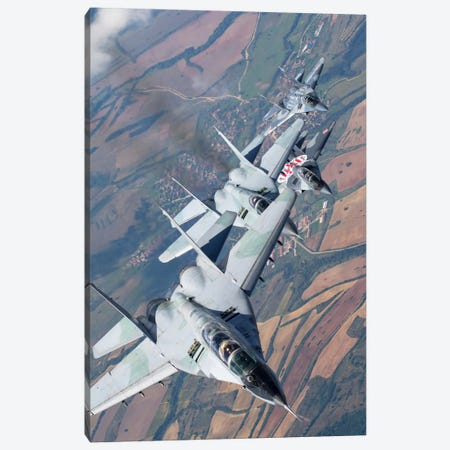 Bulgarian And Polish Air Force MiG-29s Flying Over Bulgaria I Canvas Print #TRK235} by Daniele Faccioli Canvas Art Print
