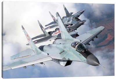 Bulgarian And Polish Air Force MiG-29s Flying Over Bulgaria II Canvas Art Print