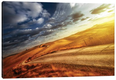 A Country Road In Field At Sunset Against Moody Sky, Tuscany, Italy. Canvas Art Print