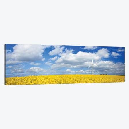 A Wind Turbine In A Canola Field Against Cloudy Sky, Denmark. Canvas Print #TRK2402} by Evgeny Kuklev Canvas Wall Art