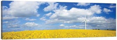 A Wind Turbine In A Canola Field Against Cloudy Sky, Denmark. Canvas Art Print