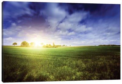 Idyllic Meadow With Sun Over Horizon Against Cloudy Sky, Denmark. Canvas Art Print
