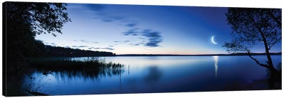 Moon Rising Over Tranquil Lake Against Moody Sky, Mozhaisk, Russia. Canvas Art Print