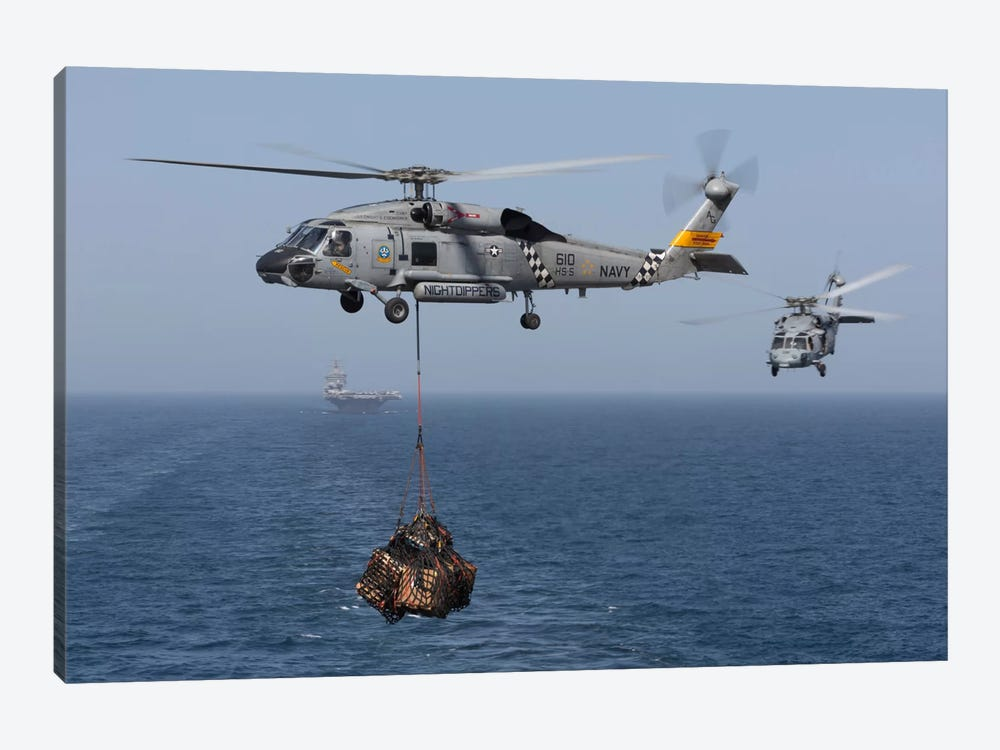 A SH-60J Seahawk Transfers Cargo During A Vertical Replenishment 1-piece Art Print