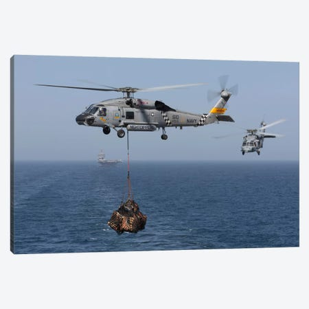A SH-60J Seahawk Transfers Cargo During A Vertical Replenishment Canvas Print #TRK249} by Gert Kromhout Art Print