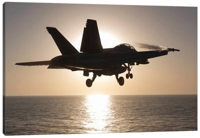 An F/A-18F Super Hornet Takes Off Into The Morning Sun Over The Arabian Sea Canvas Art Print