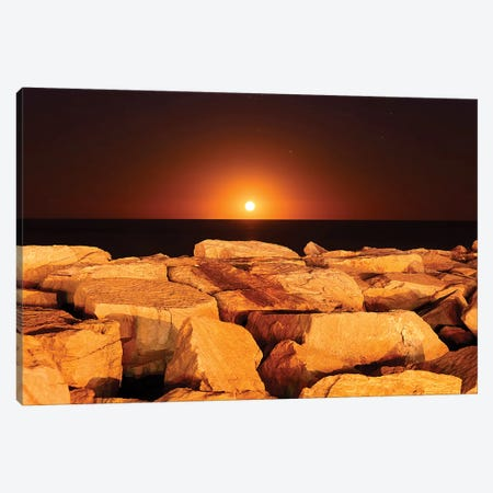 The Moon Rising Behind Rocks Lit By A Nearby Fire In Miramar, Argentina Canvas Print #TRK2654} by Luis Argerich Canvas Artwork