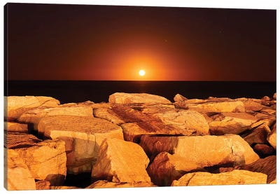 The Moon Rising Behind Rocks Lit By A Nearby Fire In Miramar, Argentina Canvas Art Print