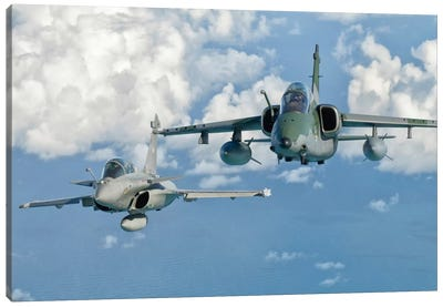 A Dassault Rafale Of The French Air Force Flys Alongside An Embraer A-1B Of The Brazilian Air Force Canvas Art Print