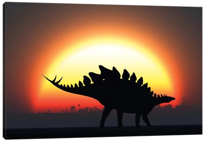 A Stegosaurus Silhouetted Against The Setting Sun At The End Of A Prehistoric Day Canvas Art Print