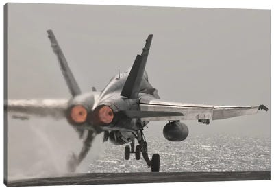 An F/A-18C Hornet Takes Off From USS George H.W. Bush Canvas Art Print