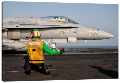 An F/A-18C Is Ready To Launch From The Flight Deck Of USS Eisenhower Canvas Art Print