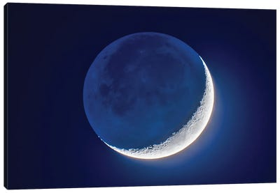 4-Day Old Waxing Crescent Moon With Earthshine. Canvas Art Print