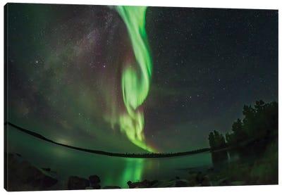 A Bright Arc Of Aurora Over The Still Waters Of Tibbitt Lake, Canada. Canvas Art Print