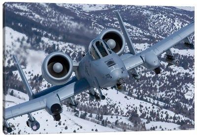 A-10C Thunderbolt Flies Over The Snowy Idaho Countryside I Canvas Art Print