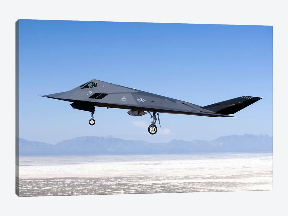 F-117 Nighthawk Flies A Training Sortie Over New Mexico by HIGH-G Productions 1-piece Canvas Wall Art