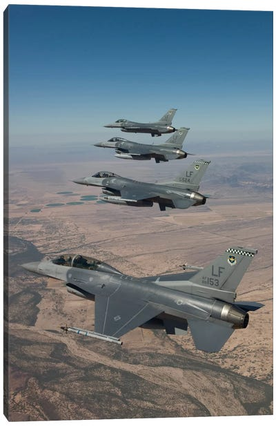 Four F-16s Maneuver On A Training Mission Over The Arizona Desert Canvas Art Print