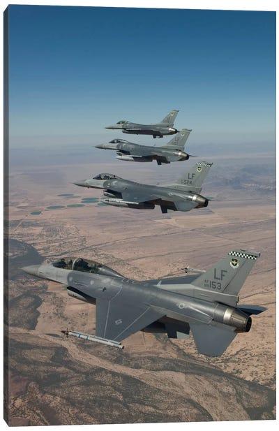 Four F-16s Maneuver On A Training Mission Over The Arizona Desert Canvas Art Print