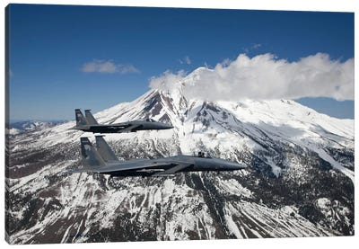 Two F-15 Eagles Fly Past Snow Capped Peaks In Central Oregon Canvas Art Print