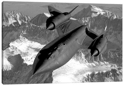 A SR-71B Blackbird Flying Across The Sierra Nevada Mountains Canvas Art Print