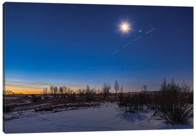 The Waning Crescent Moon Shining Above The Pairing Of Mars, Jupiter And A Streaking Space Station. Canvas Art Print