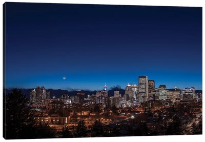 The Waxing Crescent Moon Over The Skyline Of Calgary, Canada. Canvas Art Print