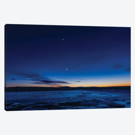 The Waxing Crescent Moon With Earthshine And Venus Over An Icy Pond In Alberta, Canada. Canvas Print #TRK3278} by Alan Dyer Canvas Art