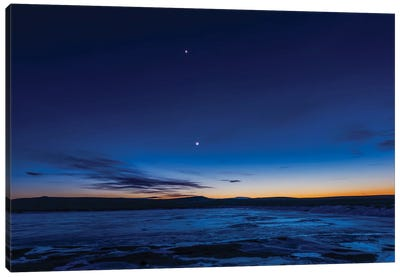 The Waxing Crescent Moon With Earthshine And Venus Over An Icy Pond In Alberta, Canada. Canvas Art Print