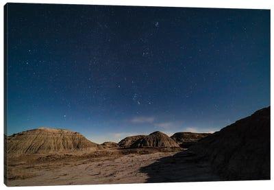 The Winter Stars Rising Over The Moonlit Badlands Of Dinosaur Provincial Park, Alberta, Canada. Canvas Art Print