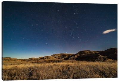 The Winter Stars Rising Over The Moonlit Sagebrush Of Dinosaur Provincial Park, Alberta, Canada. Canvas Art Print