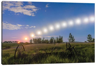 Trail Of The Waning Gibbous Moon Tracking Low Across The Sky In Alberta, Canada. Canvas Art Print