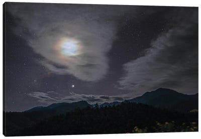 The Lunar Corona Appear Among The Passing Clouds Above The Mountain In Pai, North Of Thailand. Canvas Art Print