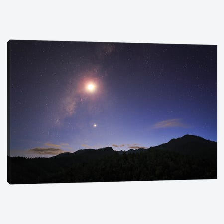 The Milky Way And Waxing Crescent Moon Shine Above The Mountain In Pai, North Of Thailand. Canvas Print #TRK3353} by Jeff Dai Canvas Art Print