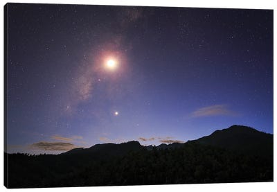 The Milky Way And Waxing Crescent Moon Shine Above The Mountain In Pai, North Of Thailand. Canvas Art Print