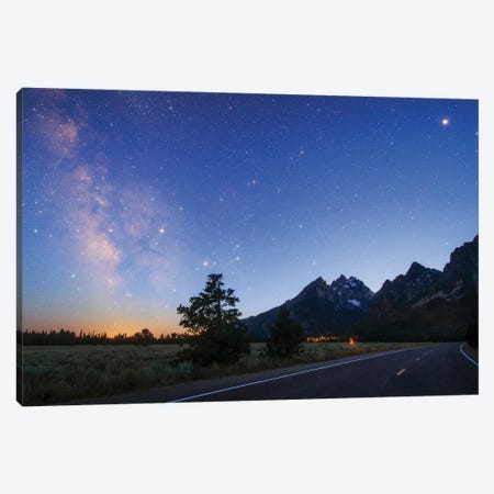 The Milky Way Appears In The Evening Twilight Above Grand Teton National Park, Wyoming, Usa. Canvas Print #TRK3354} by Jeff Dai Canvas Wall Art