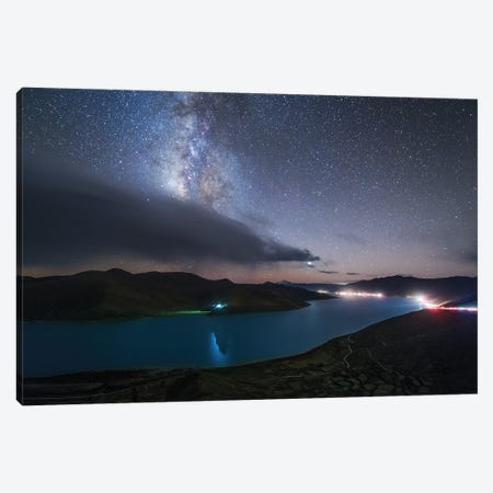 The Milky Way Shines Among The Passing Clouds Above Yamdrok Lake, Tibet, China. Canvas Print #TRK3358} by Jeff Dai Canvas Art Print
