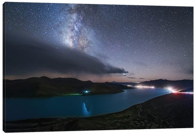 The Milky Way Shines Among The Passing Clouds Above Yamdrok Lake, Tibet, China. Canvas Art Print