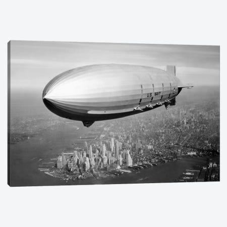 USS Macon Airship Flying Over New York City Canvas Print #TRK347} by John Parrot Canvas Print